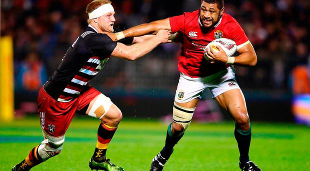 Taulupe Faletau of the Lions charges forward