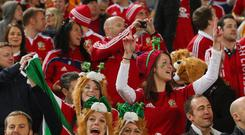 British & Irish Lions supporters celebrate during the International Test match between the Australian Wallabies and British & Irish Lions at ANZ Stadium on July 6, 2013 in Sydney, Australia. (Photo by Chris Hyde/Getty Images)