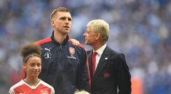 Per Mertesacker and Arsene Wenger of Arsenal line up ahead of the Emirates FA Cup Final between Arsenal and Chelsea at Wembley Stadium on May 27, 2017 in London, England. (Photo by Laurence Griffiths/Getty Images)