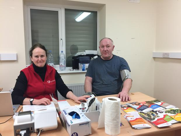 A farmer in Ballina Mart being checked by nurse Majella Munnelly.