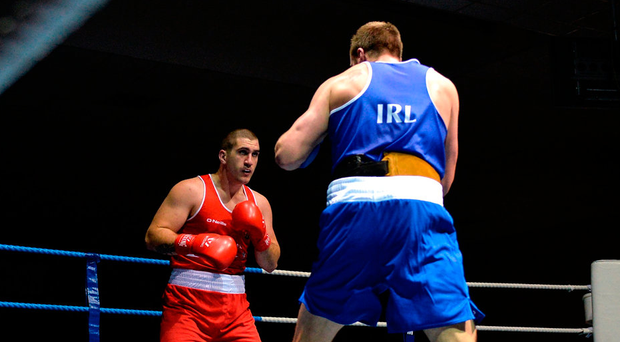 Martin Keenan from Rathkeale, in action against eventual winner, Dean Gardiner from Clonmel, during their box-off for the European Championships on Wednesday night. Photo: Piaras Ó Mídheach/Sportsfile