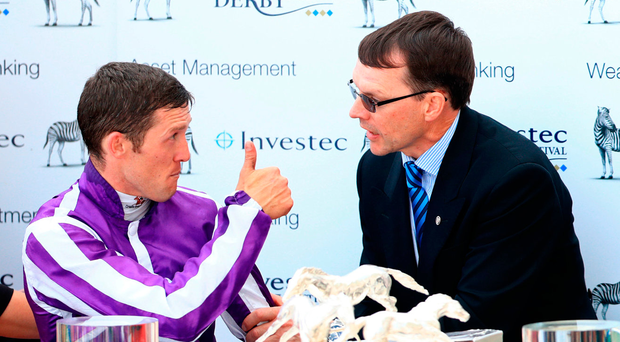 Thumbs up: Padraig Beggy and Aidan O'Brien enjoy their Derby spoils. Photo: John Walton/PA