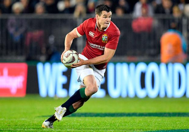 Jonathan Sexton runs with the ball during yesterday's match against the New Zealand Barbarians