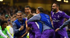 Cristiano Ronaldo of Real Madrid celebrates scoring his sides third goal with teammates during the UEFA Champions League Final between Juventus and Real Madrid at National Stadium of Wales on June 3, 2017 in Cardiff, Wales. (Photo by Matthias Hangst/Getty Images)