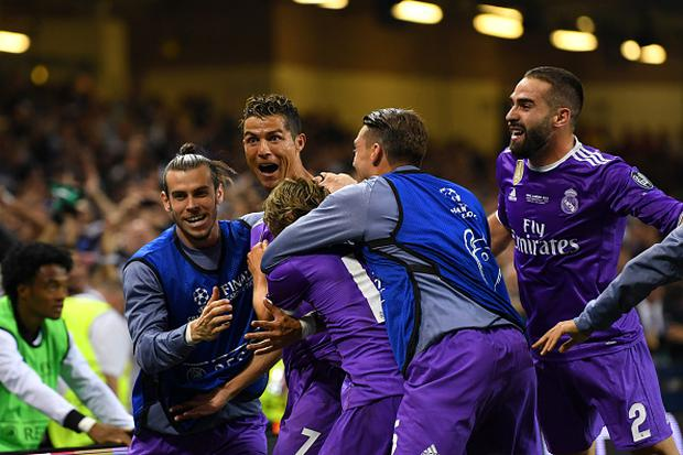 c090af13e Cristiano Ronaldo of Real Madrid celebrates scoring his sides third goal  with teammates during the UEFA