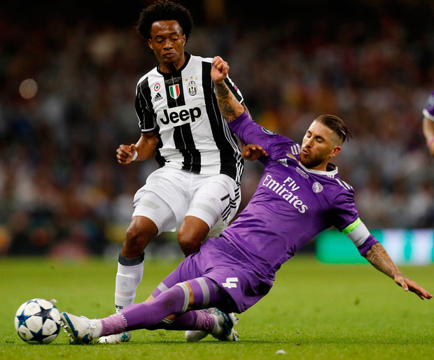 Juventus' Juan Cuadrado in action with Real Madrid's Sergio Ramos. Photo: John Sibley/Reuters