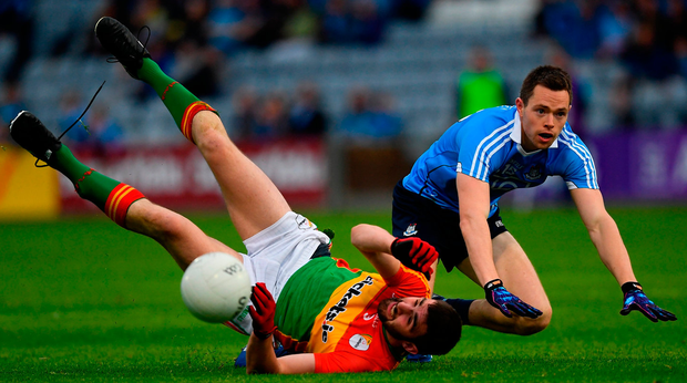 Dean Rock of Dublin has his shot blocked by Séan Murphy. Photo: Sportsfile