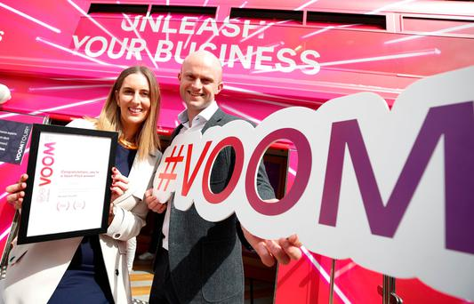 Coroflo CEO Rosanne Longmore and Aidan D'Arcy, Head of Business Virgin Media Ireland, after Coroflo won the Virgin Media Business Voom Tour event. Photo: Conor McCabe Photography