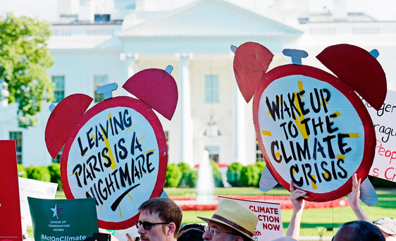 Alarmed reaction: Demonstrators outside the White House protest against President Trump's decision to withdraw the US from the Paris climate change accord. Photo: AP photo