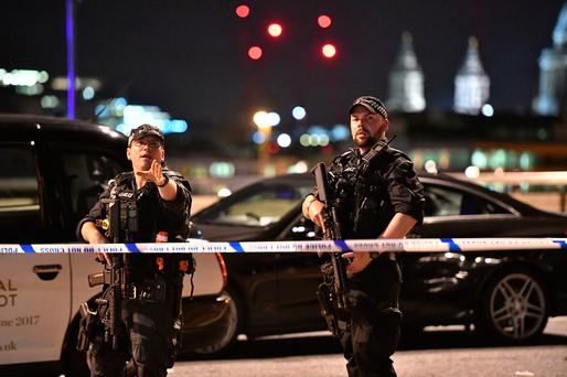 Armed Police officers on London Bridge as police are dealing with a