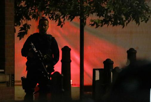 An armed police officer keeps watch after an incident near London Bridge in London, Britain June 4, 2017. REUTERS/Neil Hall