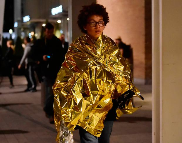 People leave the area wearing foil blankets after an incident near London Bridge in London, Britain June 4, 2017. REUTERS/Hannah Mckay