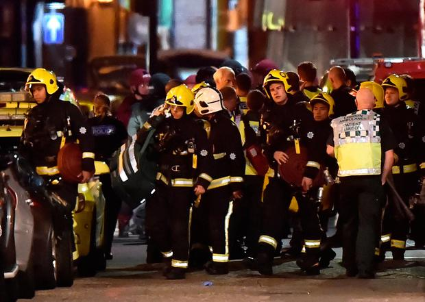 Rescue personnel assemble after an incident near London Bridge in London, Britain June 4, 2017. REUTERS/Hannah Mckay