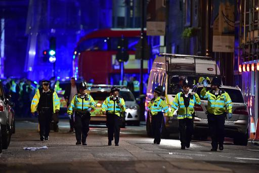 Police officers on Borough High Street during last night's