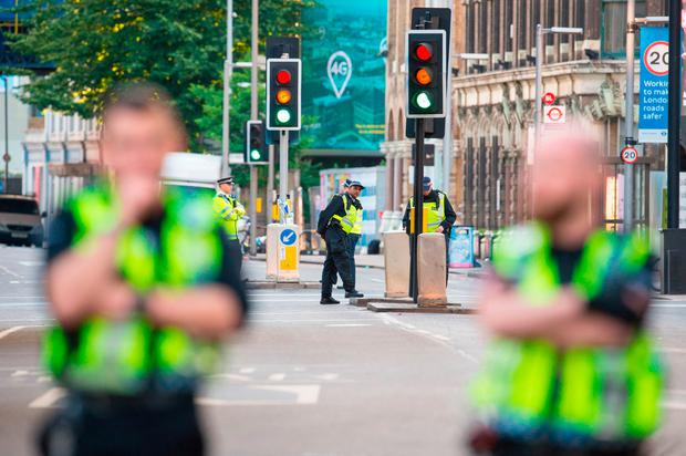 Police cordon off the area around at the scene in London Bridge and Borough Market in London following last night's terrorists incidents. Dominic Lipinski/PA Wire