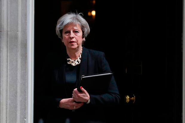 Prime Minister Theresa May prepares to make a statement in Downing Street after chairing a meeting of the Government's emergency Cobra committee following last night's terrorist incident in London. Andrew Matthews/PA Wire