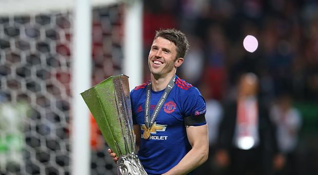Michael Carrick of Manchester United celebrates with the trophy during the UEFA Europa League Final match between Ajax and Manchester United at Friends Arena on May 24, 2017 in Stockholm, Sweden. (Photo by Catherine Ivill - AMA/Getty Images)