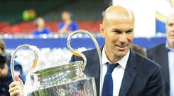 Real Madrid manager Zinedine Zidane poses with the UEFA Champions League trophy during the UEFA Champions League Final match between Juventus and Real Madrid at National Stadium of Wales on June 3, 2017 in Cardiff, Wales. (Photo by Kevin Barnes - CameraSport via Getty Images)