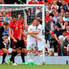 Carrick All Stars' Gaizka Medieta (centre right) celebrates scoring his side's first goal of the game with team-mate Robbie Keane (centre left) during Michael Carrick's Testimonial match at Old Trafford
