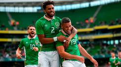 Jonathan Walters of Republic of Ireland celebrates with Cyrus Christie, left, after scoring his side's first goal of the game during the international friendly match between Republic of Ireland and Uruguay at the Aviva Stadium in Dublin. Photo by Ramsey Cardy/Sportsfile