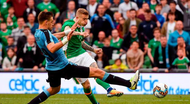 James McClean of Republic of Ireland shoots to score his sides third goal, depite the attentions of Sebastian Coates of Uruguay during the international friendly match between Republic of Ireland and Uruguay at the Aviva Stadium in Dublin. Photo by David Maher/Sportsfile