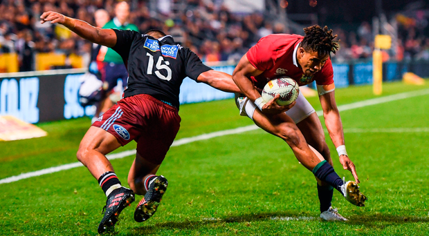 Anthony Watson of the British and Irish Lions beats the tackle of Luteru Laulala of the New Zealand Provincial Barbarians on his way to scoring his side's try. Photo by Stephen McCarthy/Sportsfile
