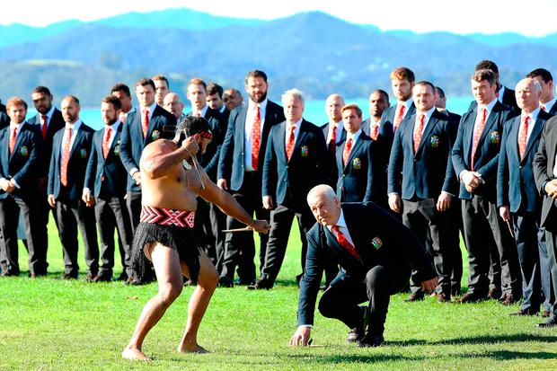 A Maori warrior lays a challenge down for Lions head coach Warren Gatland during a Maori Welcome at Waitangi Treaty Grounds yesterday. Photo by Hannah Peters/Getty Images