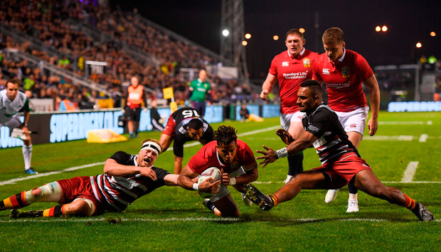 Anthony Watson dives over for the Lions' only try. Photo by Stephen McCarthy/Sportsfile