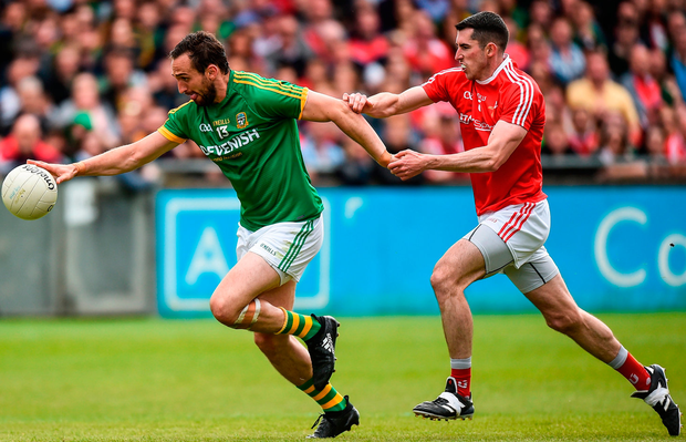 Meath's Graham Reilly pulls away from Louth's John Binghamat Parnell Park. Photo: Matt Browne/Sportsfile