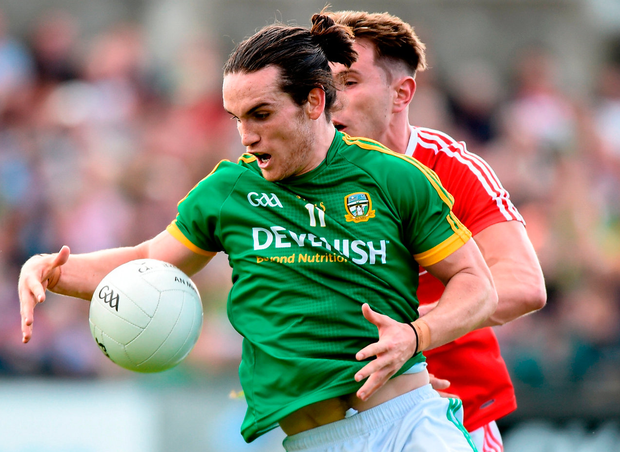 Cillian O'Sullivan of Meath in action against James Stewart of Louth. Photo: Matt Browne/Sportsfile