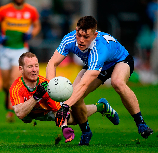 Danny Moran of Carlow in action against Con O'Callaghan of Dublin at O'Moore Park, Portlaoise. Photo: Ray McManus/Sportsfile