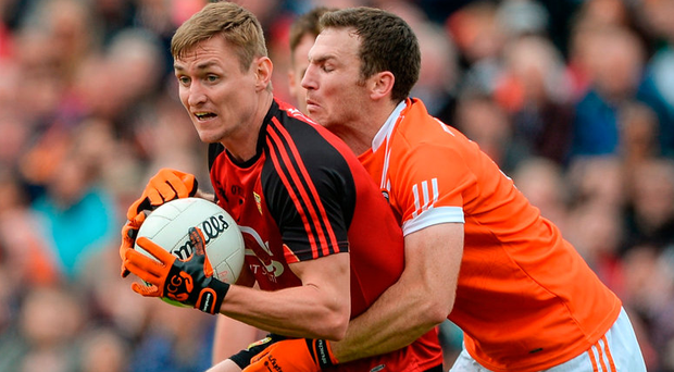 Caolan Mooney of Down in action against Brendan Donaghy of Armagh. Photo: Daire Brennan/Sportsfile