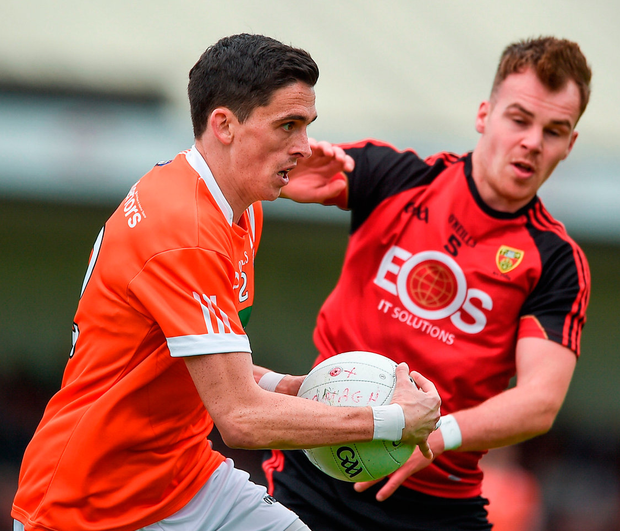 Rory Grugan of Armagh in action against Darragh O'Hanlon of Down. Photo: Philip Fitzpatrick/Sportsfile