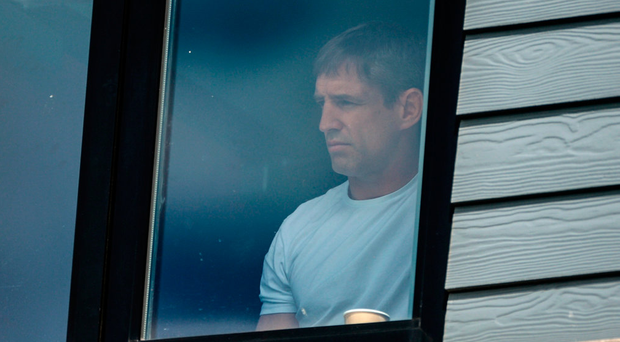 Armagh manager Kieran McGeeney watches the game from the clubhouse at Páirc Esler. Photo: Daire Brennan/Sportsfile