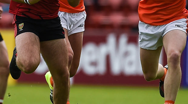 Conor Clarke of Down in action against James Haughey of Armagh during the Ulster GAA Football Minor Championship Quarter-Final match. Photo: Philip Fitzpatrick/Sportsfile