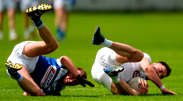 Kildare's Fergal Conway comes away with possession after a collision with Damien O'Connor of Laois in O'Connor Park. Photo: Piaras Ó Mídheach/Sportsfile