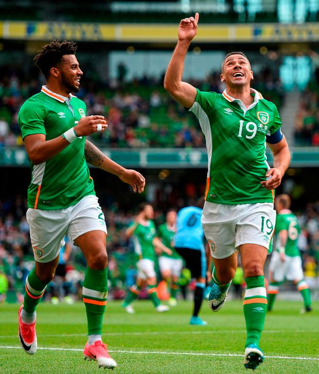 Jonathan Walters celebrates with Cyrus Christie, left, after scoring Ireland's opener against Uruguay at the Aviva Stadium. Photo: Ramsey Cardy/Sportsfile