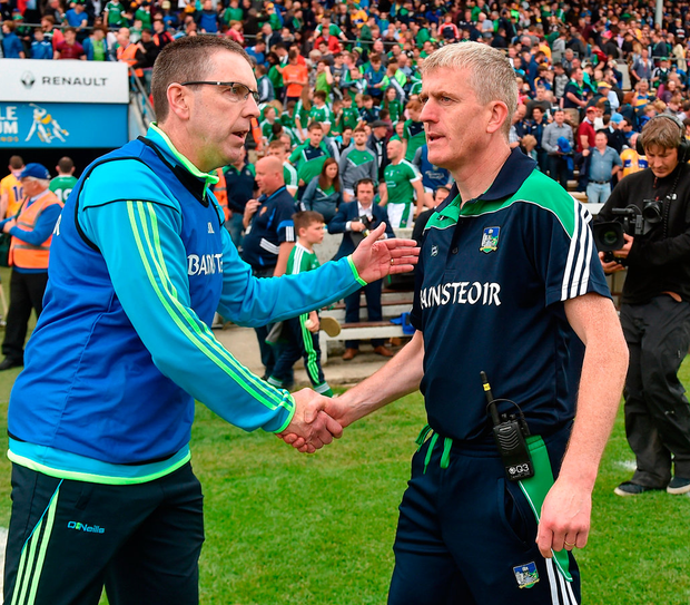 Clare joint manager Gerry O'Connor and Limerick manager John Kiely exchange a handshake after the match. Photo: Diarmuid Greene/Sportsfile