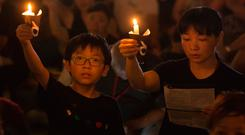 Tens of thousands of people attend an annual candlelight vigil at Hong Kong's Victoria Park. Photo: AP