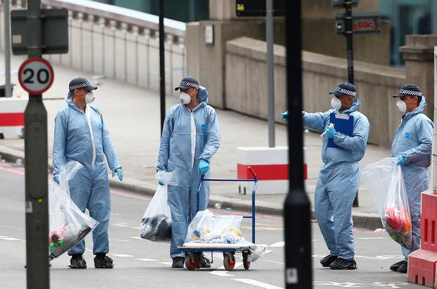 Forensics investigators work on London Bridge, after an attack left 7 people dead and dozens injured, in London, Britain June 4, 2017. REUTERS/Neil Hall