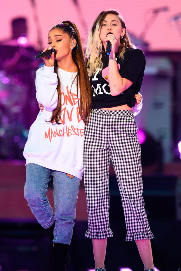 Ariana Grande and Miley Cyrus perform at the charity gig. (Photo by Getty Images/Dave Hogan for One Love Manchester)