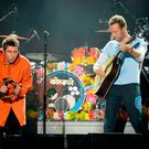 NO SALES. Free for editorial use. Handout photo issued by One Love Manchester of Liam Gallagher (left) and Chris Martin (right) performing during the One Love Manchester benefit concert for the victims of the Manchester Arena terror attack at Emirates Old Trafford, Greater Manchester. PRESS ASSOCIATION Photo. Picture date: Sunday June 4, 2017. Donate at www.redcross.org.uk/love See PA story POLICE Explosion. Photo credit should read: Dave Hogan for One Love Manchester/PA Wire