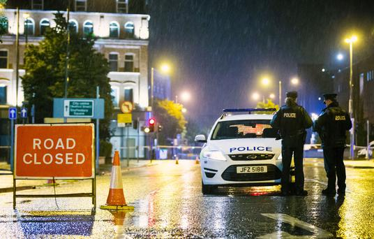 Police officers at the scene of a fatal stabbing at the Little Victoria Street car park on Bruce Street in Belfast (Photo - Kevin Scott / Belfast Telegraph)
