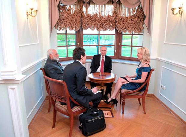 Russian President Vladimir Putin (2nd R) and Indian Prime Minister Narendra Modi (L) talk to journalist Megyn Kelly (R) on the sidelines of the St. Petersburg International Economic Forum (SPIEF) at the Constantine (Konstantinovsky) Palace, Russia