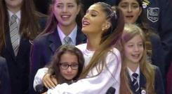 Ariana Grande embraced a young fan on stage PIC: BBC