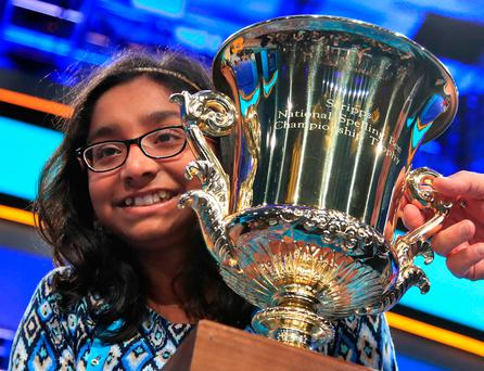 Ananya Vinay, 12, from Fresno, Calif., holds the trophy after being declared the winner of the 90th Scripps National Spelling Bee, in Oxon Hill, Md., Thursday, June 1, 2017. (AP Photo/Manuel Balce Ceneta)