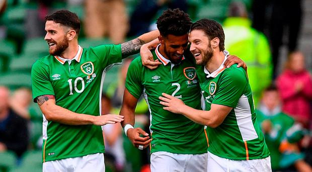 Cyrus Christie of Republic of Ireland celebrates with Jeff Hendrick, left, and Harry Arter, right, after scoring his side's second goal during the international friendly match between Republic of Ireland and Uruguay at the Aviva Stadium in Dublin. Photo by Ramsey Cardy/Sportsfile