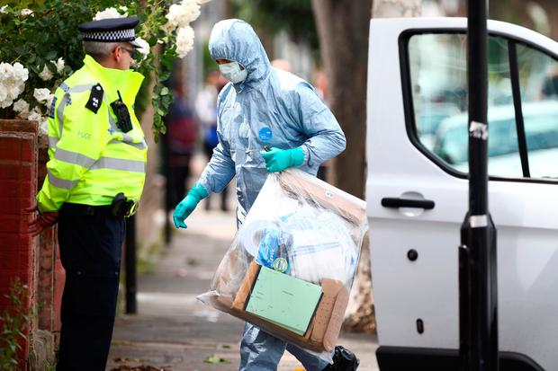 Forensics investigators work at a property which was raided by police in East Ham, east London, Britain, June 5, 2017. REUTERS/Neil Hall