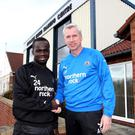 NEWCASTLE UPON TYNE, UNITED KINGDOM - FEBRUARY 25: Newcastle United manager Alan Pardew (R) shakes hands with Cheik Tiote after the midfielder agreed a new contract on February 25, 2011 in Newcastle Upon Tyne, England. (Photo by Ian Horrocks/Newcastle United via Getty Images)