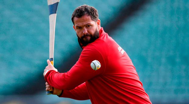 Lions defence coach Andy Farrell tries his hand at hurling during yesterday's training session at the QBE Stadium in Auckland. Photo: Stephen McCarthy/Sportsfile